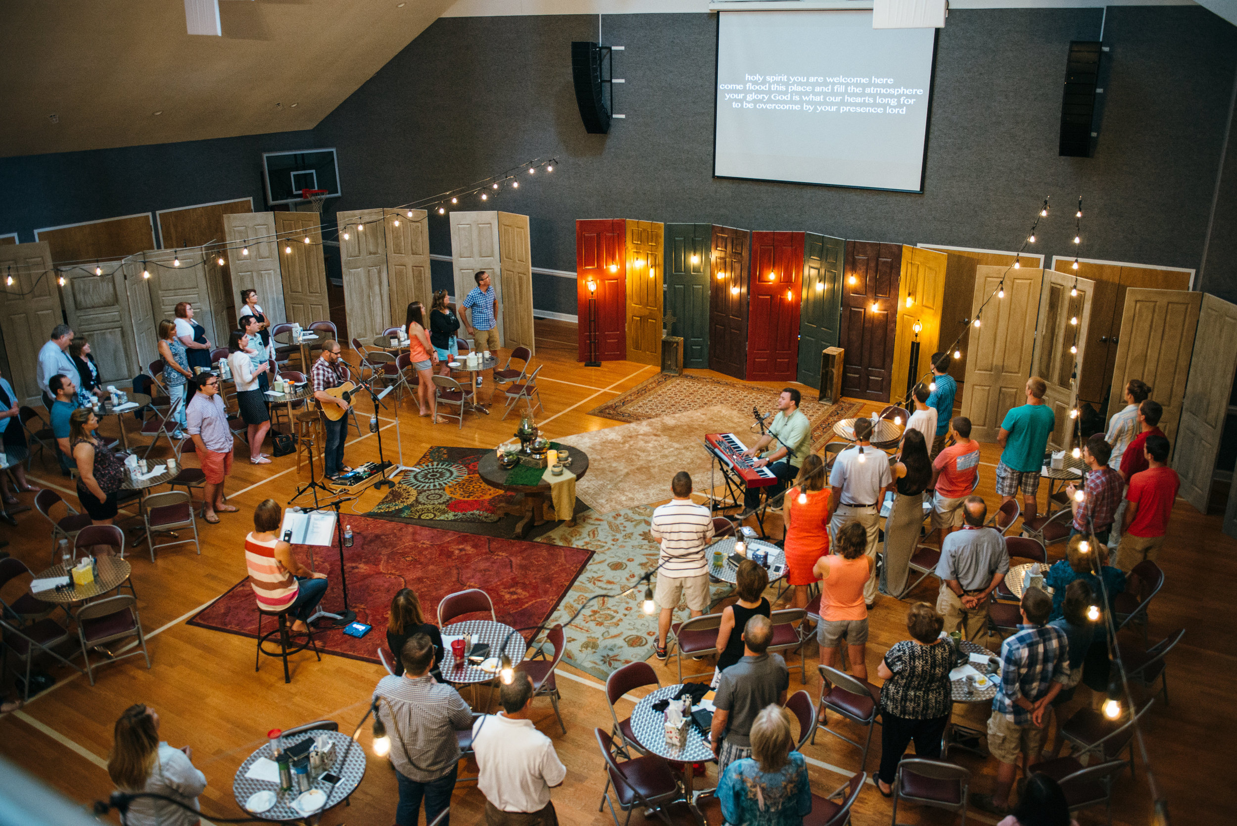 worship in the round… - in 2016, we got rid of the stage! putting the communion table in the center of the room and leading from the same level as the community reinforces the truth: that God works through all of us, and that no one is set above or more worthy than another.