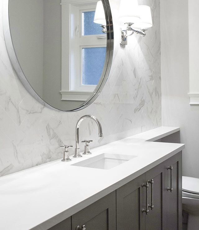 There just something about traditional details and polished nickel that makes me feel all cozy and happy. . . . #powderroomdesign #northvancouverrenovations #herringbonepattern #marbletilewall #customcabinets #roundmirror #powderroomrenovation  @restoration.hardware @cantubathrooms @caesarstoneca @tierrasolceramictile @kiaporterphoto 📷