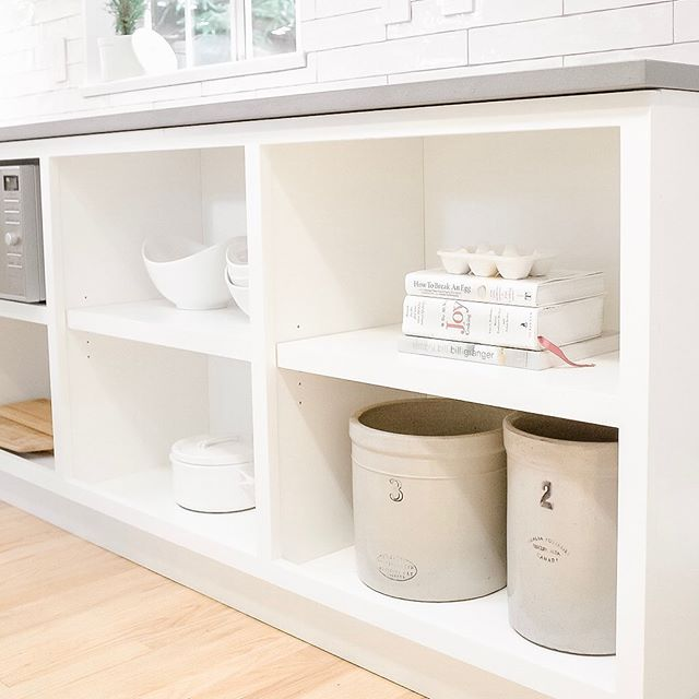Open lower shelving ❤️. Adds fantastic interest, easy to access, and gives a space to show off all your neat kitchen collectables! . . . #twentyfirstwestproject #kitchenrenovation #kitchendesign #countrykitchendecor #opencabinets #northvancouverrenovations #whitecabinets @reynoldscabinetshop @caesarstoneca @tierrasolceramictile @kiaporterphoto 📷
