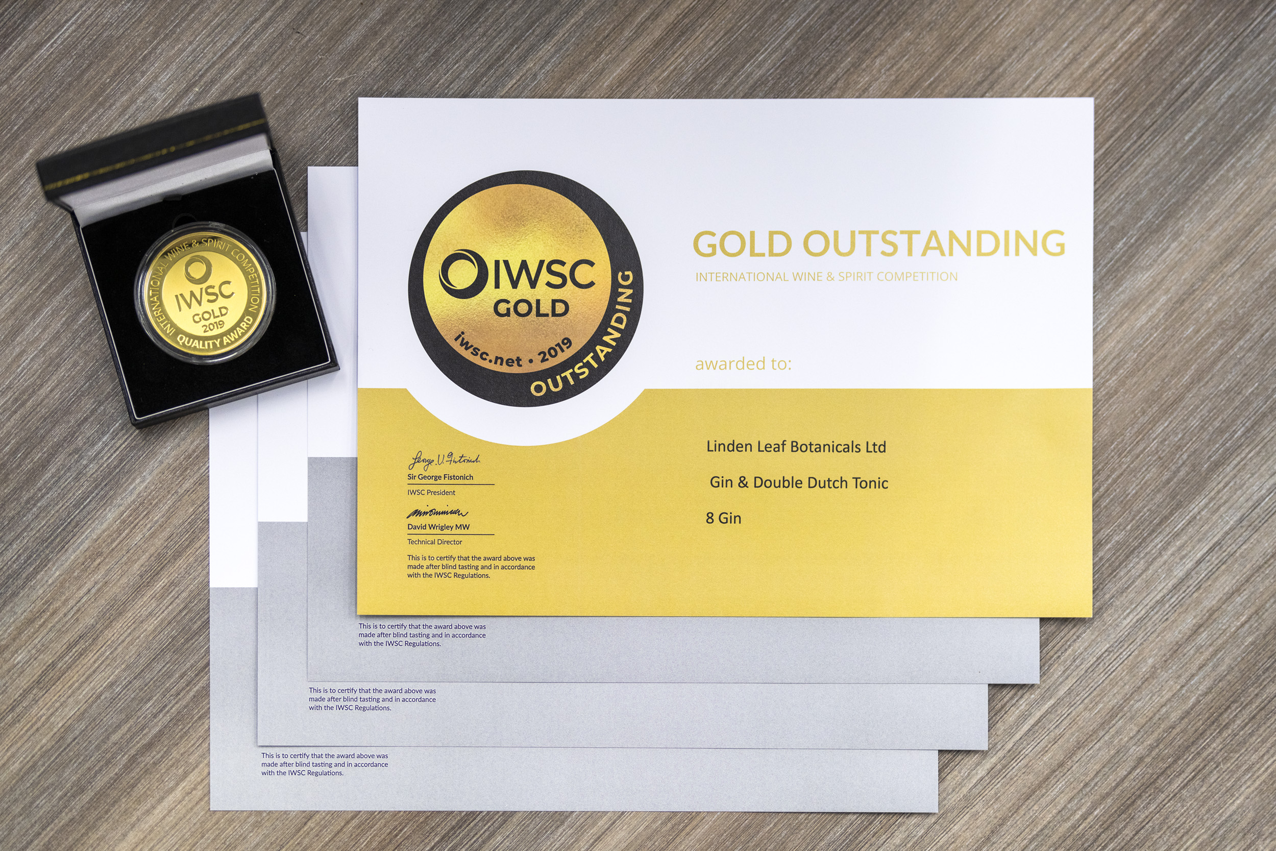 "IWSC Gold Outstanding medal and awards for Linden Leaf ""8"" and ""88"" gins"