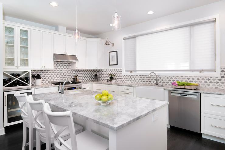white-kitchen-cabinets-super-white-quartzite-countertops-white-x-back-stools.jpg