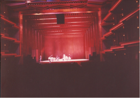 A poor photo, but the only one I have of looking at the stage at the piano I would later be playing.