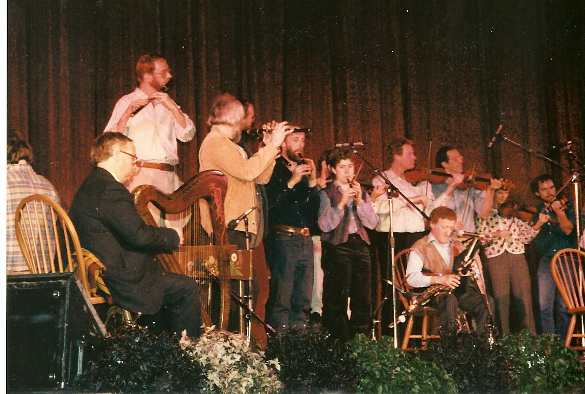 Musicians playing with the Chieftains at the Colonial ( __ = not known, or remembered) Gordon (back to audience) Derek Bell, __ Matt Molloy, Bill Thomas, __ Sarah Bauhan, Sean Keane, Paddy Moloney, Rodney Miller, Jane Orzechowski, Kerry Elkin.