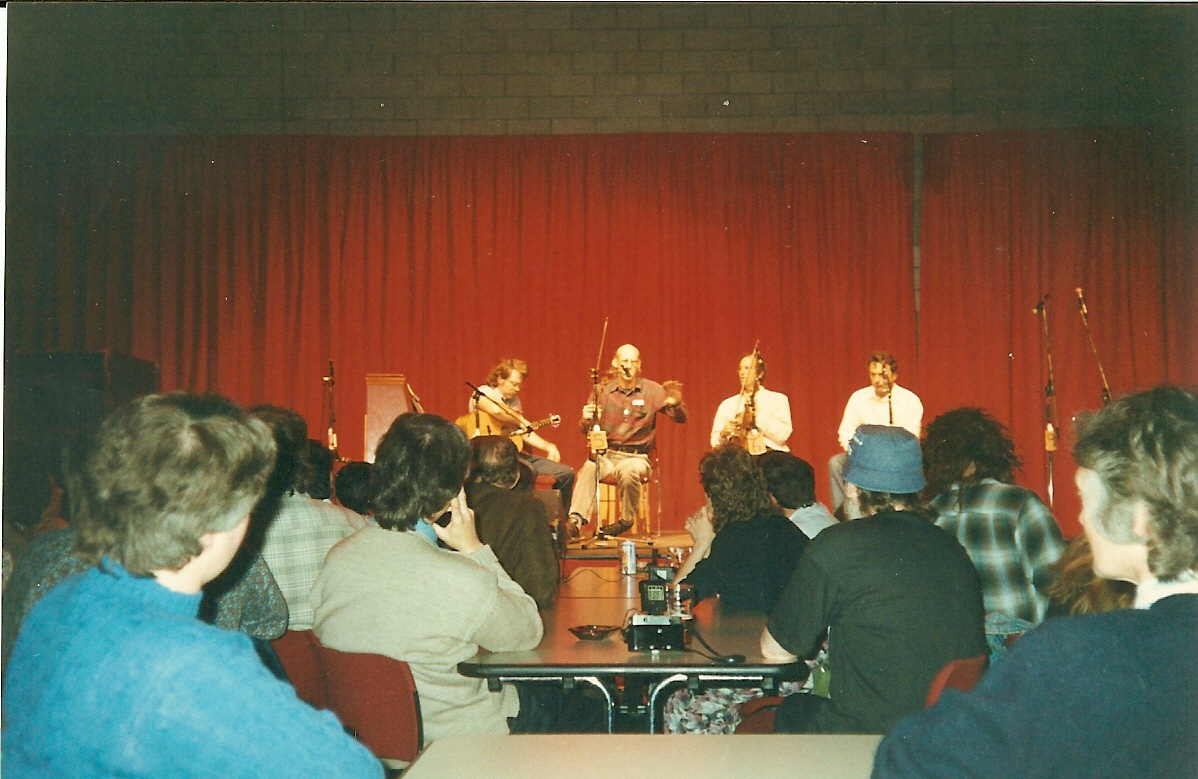 The New Hampshire Fiddlers Union: Gordon (guitar) Randy Miller, Rodney Miller, Skip Gorman, playing for a very educated audience.