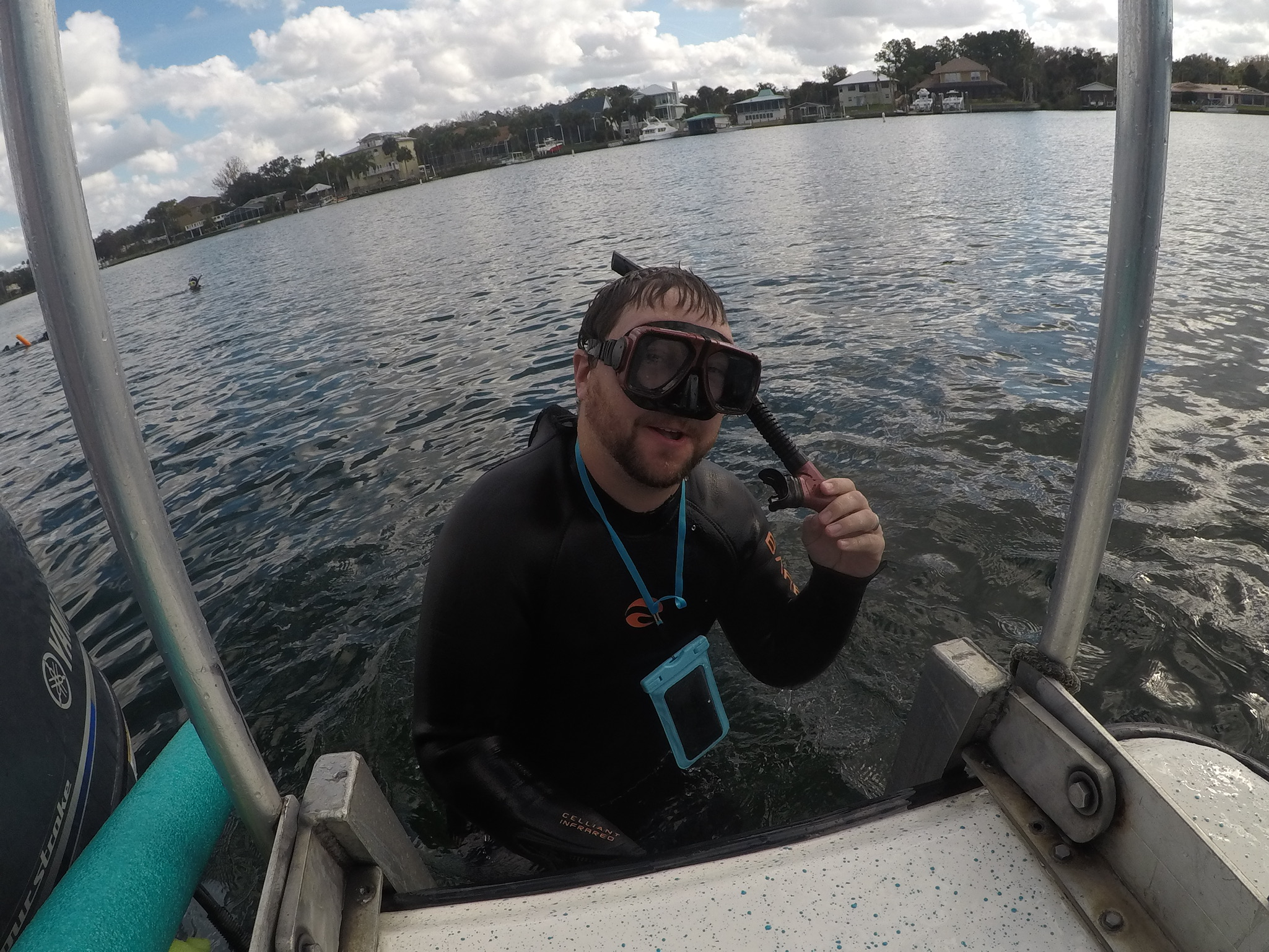 Trevor getting on the boat after swimming with manatees.