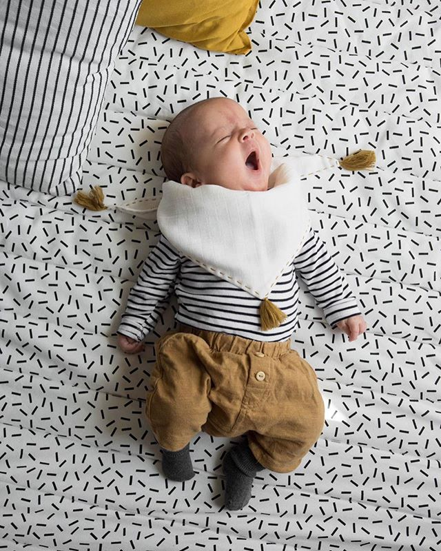 It must be exhausting being this cute. Little Denny snoozing in our tassel bib. @rosiecaitlin  Our Tassel bib can be used as a muslin, comforter, bib or dribble bib