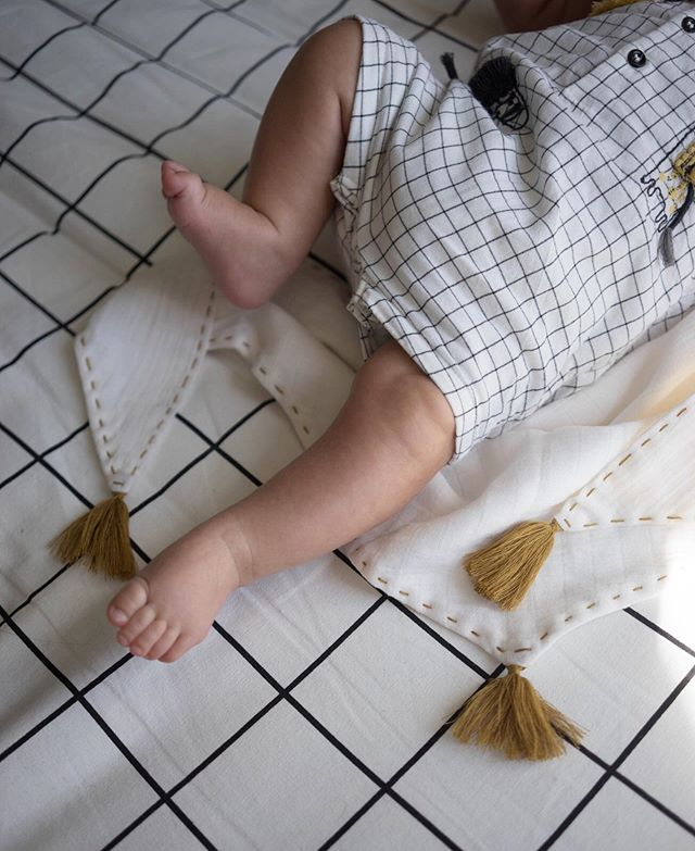 Those little legs 💛  Our Tassel bib used as a baby comforter.