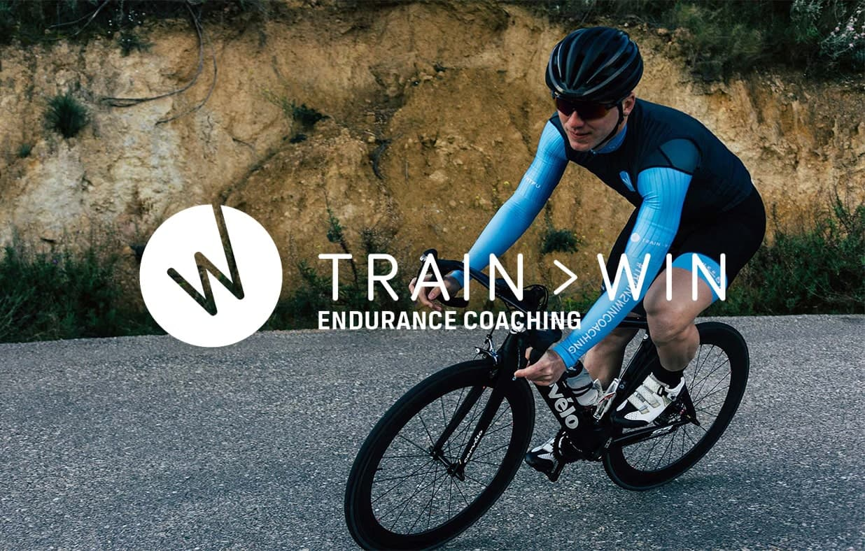 train2win endurance coaching cyclist riding downhill on a road bike.jpg