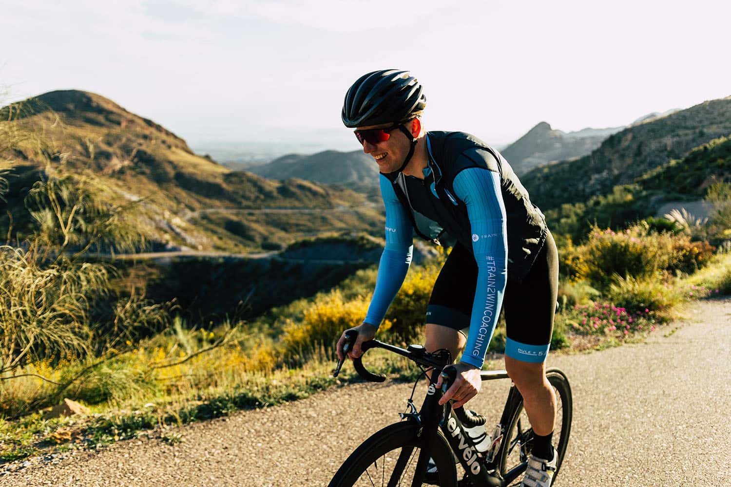 train2win endurance coaching athlete riding up the hill edi-min.jpg