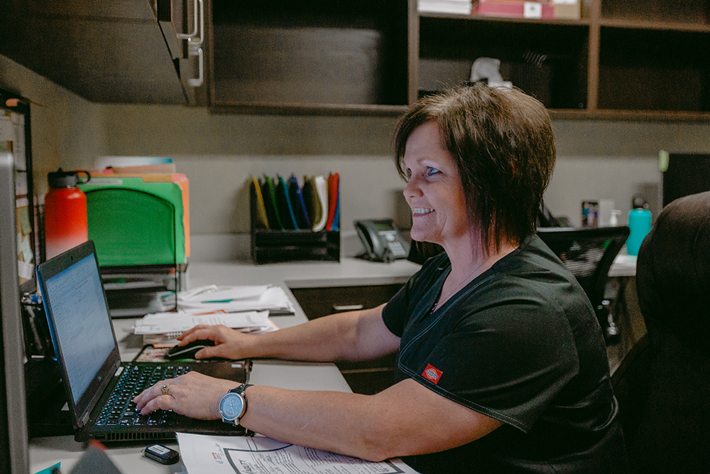 Female staff member on the computer.