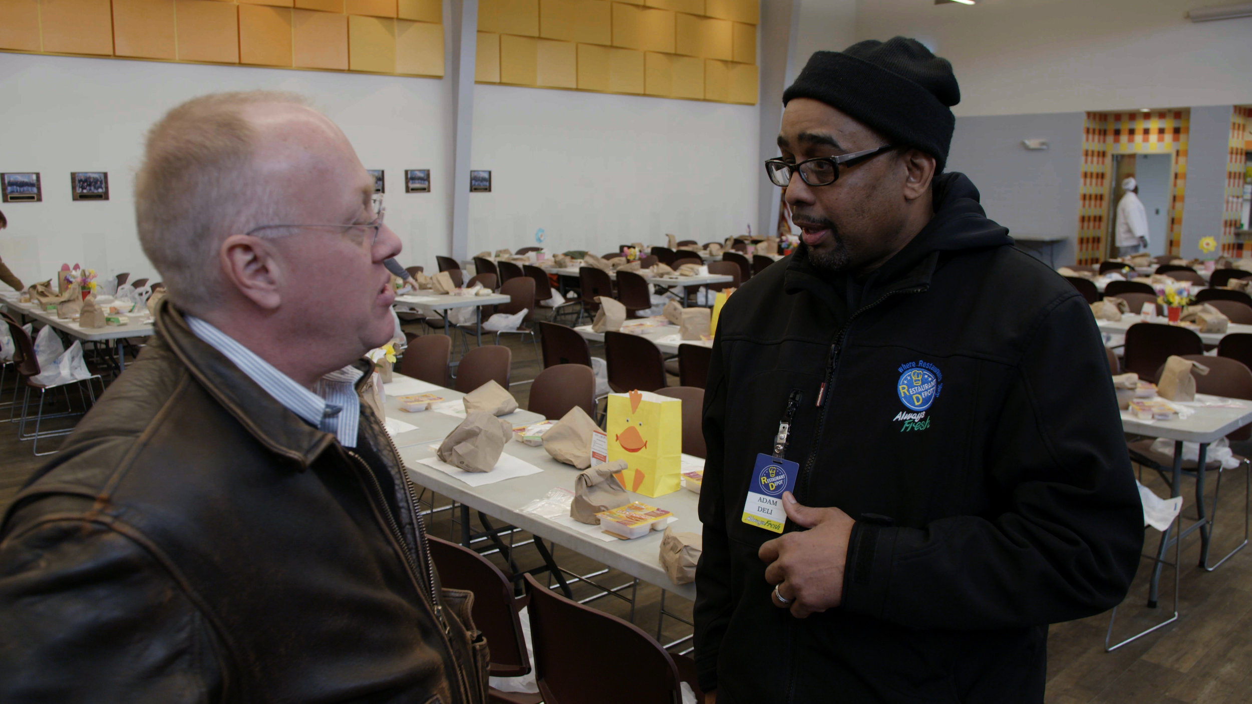 Journalist Chris Hedges with Kitchen Volunteer Delton Adams_The Corporate Coup d'État © White Pine Pictures 2018.jpg