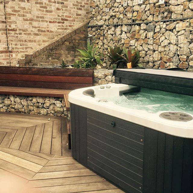Spa completed set with stacked stone surround.jpg