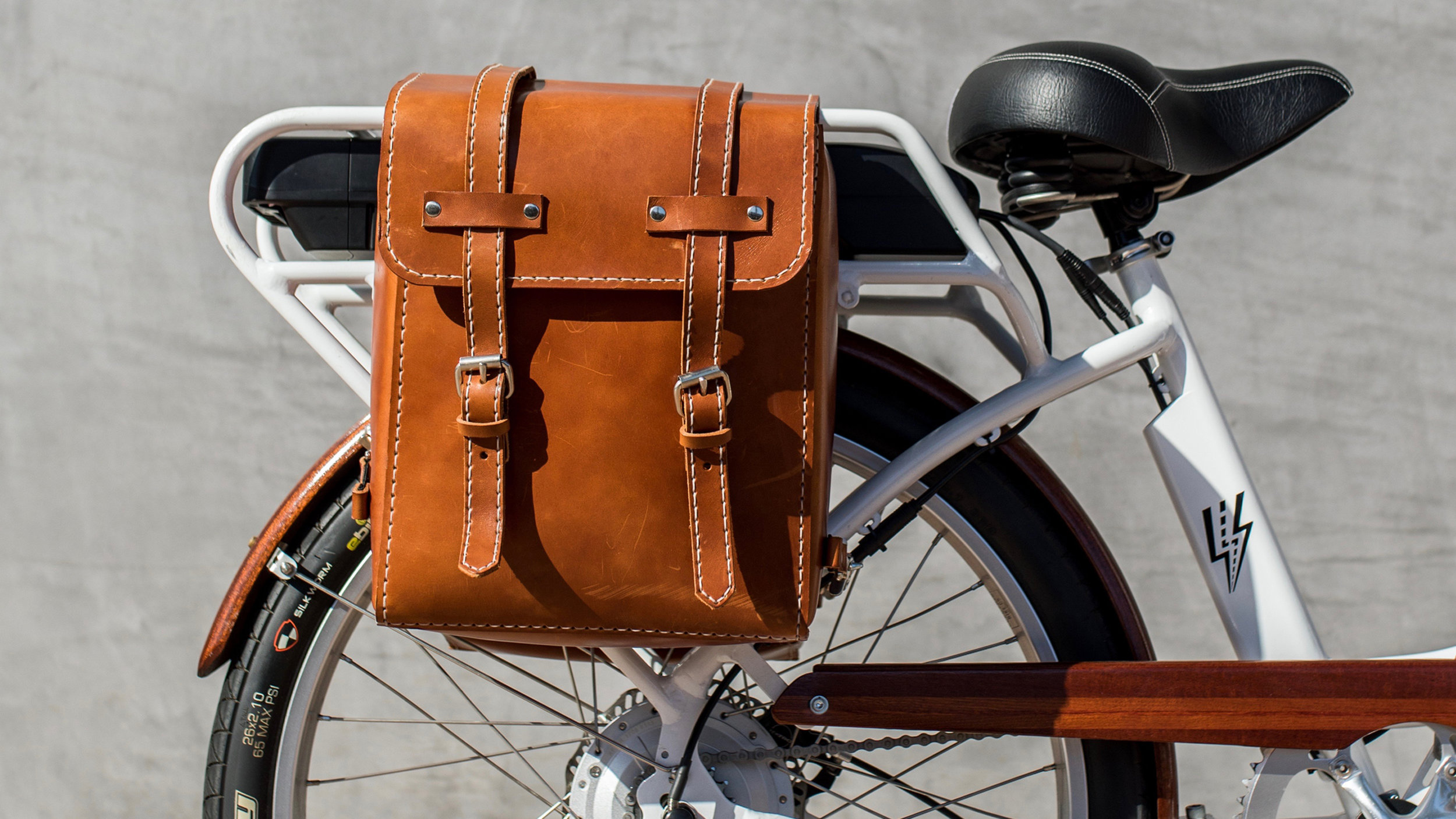 electrified-reviews-electric-bike-company-model-c-electric-bike-review-leather-saddle-bags-brown.jpg