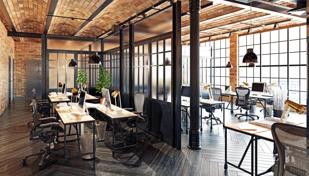 Industrial Loft - Arbeiten wie im New York SoHo Loft! Dieser Stil besticht durch offene Flächen, unterteilt von Glas und schwarzen Metallelementen, die durchsetzt mit Holz und Pflanzen sind. Warme LED Glühlampen kombiniert mit funktional weißen Spot-Lichtern und offenen Kommunikations- & Sitzflächen, schaffen ein einzigartiges Arbeitsklima.