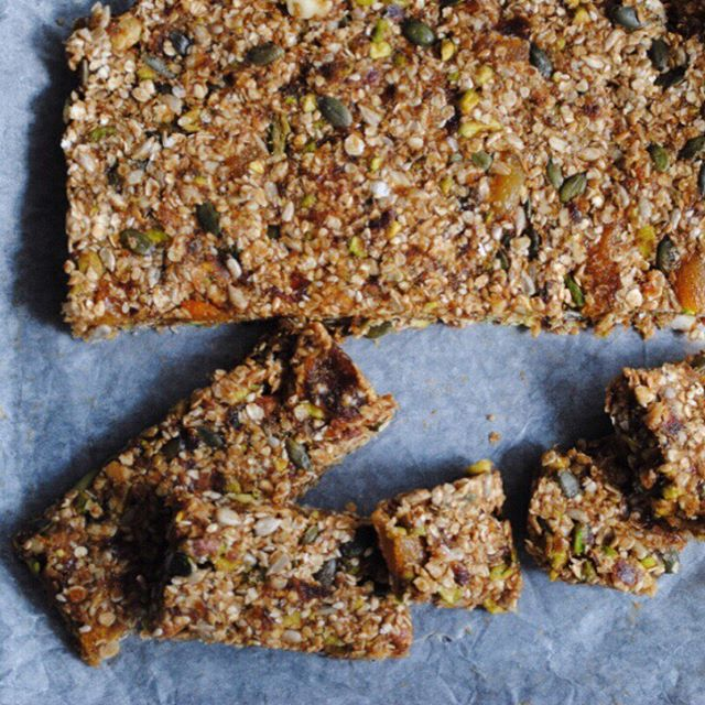 Our Super Seed Bars.  These no-bake bars are super duper healthy. No refined sugar, and lots of fibre and good fats from the oats, nuts, and seeds. ⠀⠀ When I made these, I used what I had available. Dried apricots leftover from a recipe made months ago, plus some dates, pistachios, almonds and LOTS of seeds. I have a never-ending amount of flaxseed (anyone else have this problem? They really should come in smaller packages, if you ask me.) ⠀⠀ In our household, seeds are a staple. There is hardly the type of seed that Arabs haven't roasted, salted and cracked between their teeth! From watermelon to pumpkin to sunflower, seeds are often the go-to choice for munching in front of the tv. Forget coins, we've lost many pumpkin seed skins in our sofa… ⠀⠀ We've yet to lose these bars tho. . . . #seeds #healthybreakfast #healthyliving #healthysnacks #nutsandseeds #nobake #snacks #feedfeedvegan #veganfoodshare #vegantreats #snacksmart #eatnatural #cleaneats #granolabars #heresmyfood