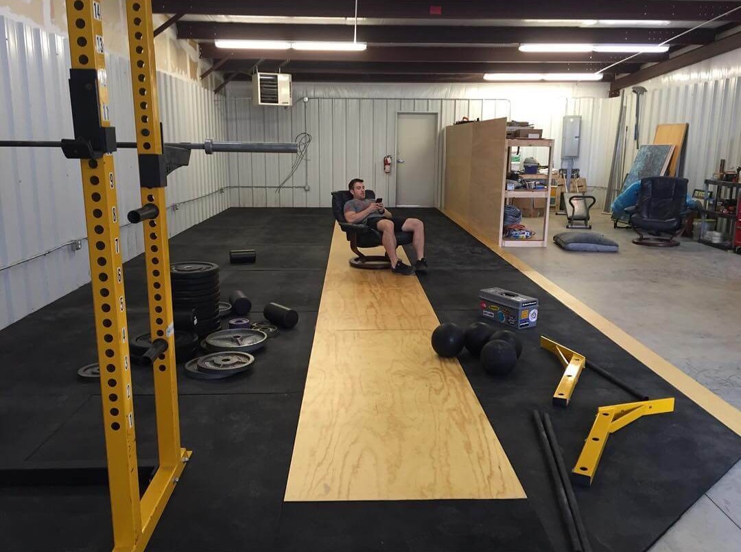 Kyle taking a break from assembling equipment in Strength Ratio's brand new gym space in 2017