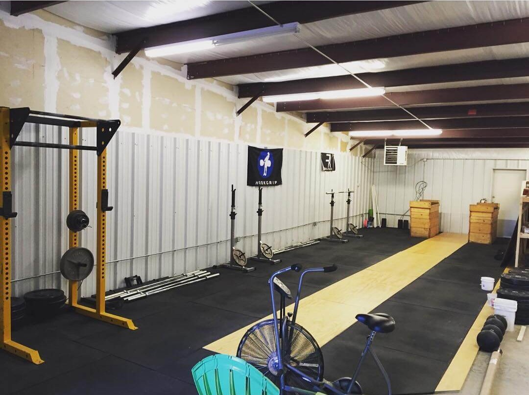 Strength Ratio's first gym space in 2017: half a warehouse, 3 squat racks, an air dyne, some plates, and a lot of potential