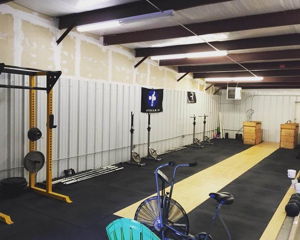 Strength Ratio's first gym space in 2017: half a warehouse, 3 squat racks, 1 air dyne, and a lot of potential