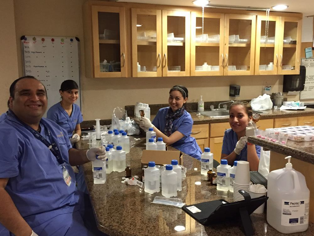 Early morning shift. The nurses prepare Vit C and B17 infusions for all the patients today