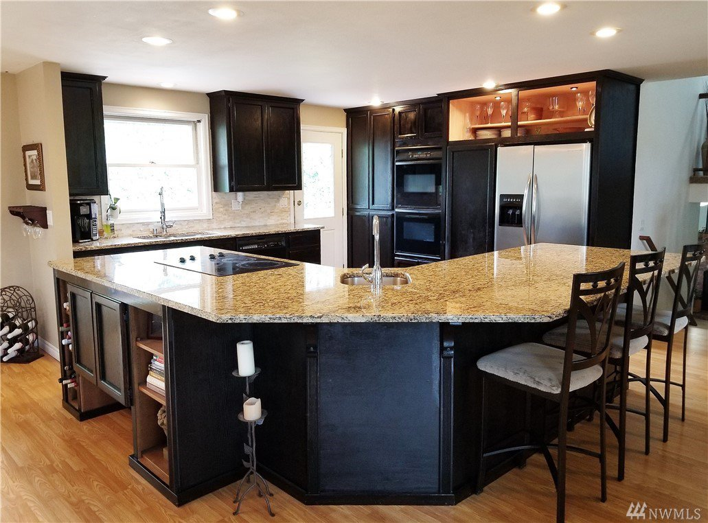 massive granite island with prep sink -