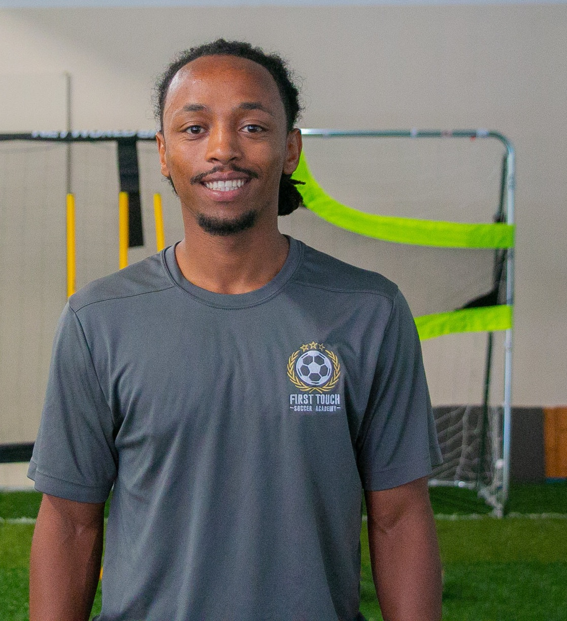 Meet Head Coach Teddy Vickers - Teddy's passion for soccer began in his childhood, playing with friends of all ages in the streets of Addis Ababa, Ethiopia. After moving to Texas, Teddy was chosen to train with the Houston Dynamo Youth Academy and participated in an elite summer program with the Houston Texans SC in Europe where he was selected as MVP during multiple games in Spain and England.Teddy began his collegiate soccer career as an attacking midfielder at Carson-Newman University, participating in their conference-winning season which won them a place in the NCAA division finals. He moved to Austin to play with the Concordia University Tornados during their historic first winning season in school history.Teddy has been coaching soccer since middle school, volunteering with the local youth leagues as a young boy and more recently coaching seven seasons with Austin's Lonestar Soccer League. His proudest moment as a coach was watching his under-10 team win the Lonestar Spring Shootout in 2017.Book a session with Teddy ➝