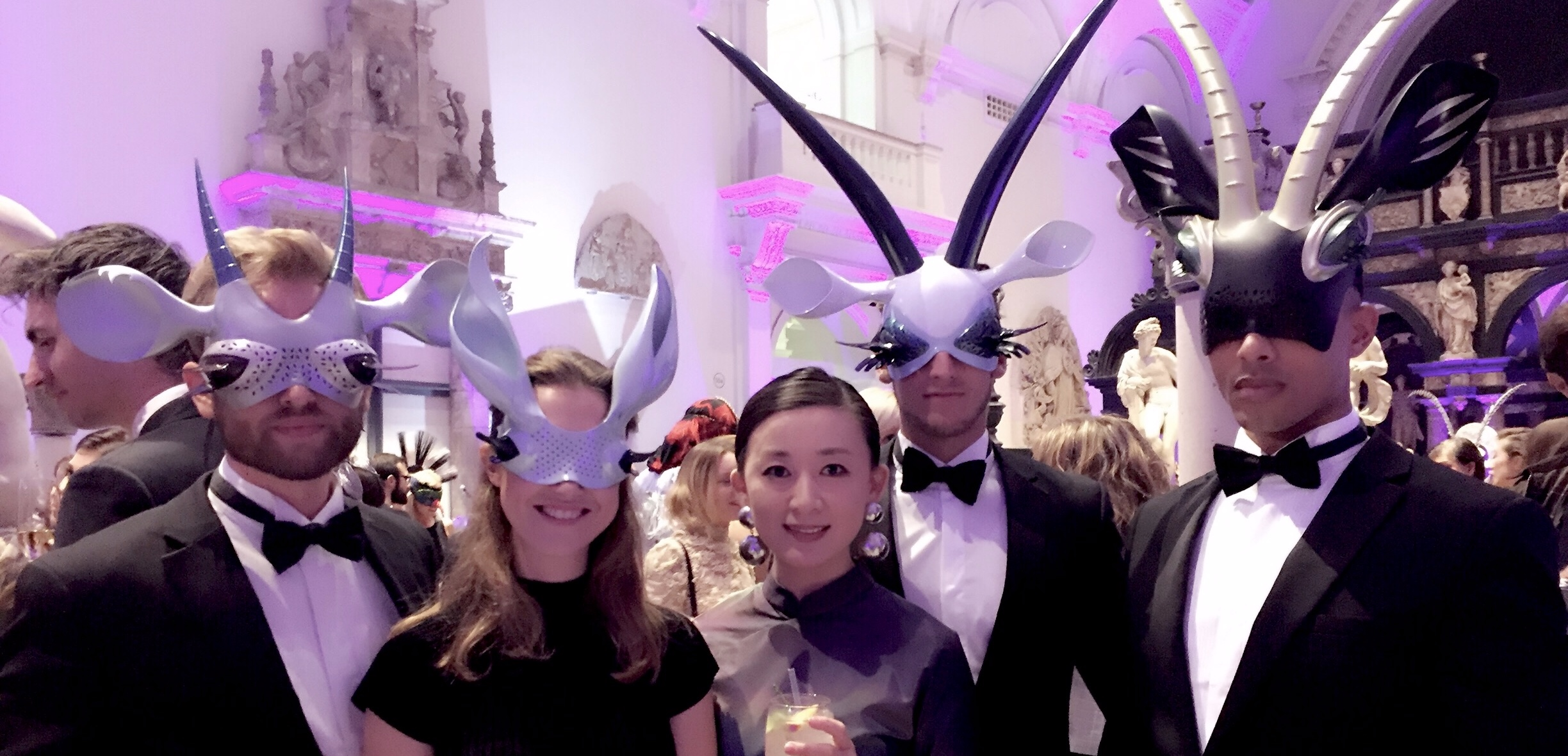 Rui XU with her antelope masks worn by guests at the opening of the Animal Ball by The Elephant Family, V&A, 2016
