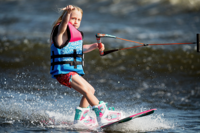 Girl wakeboarding at flawless wakes kids summer camp in barrie
