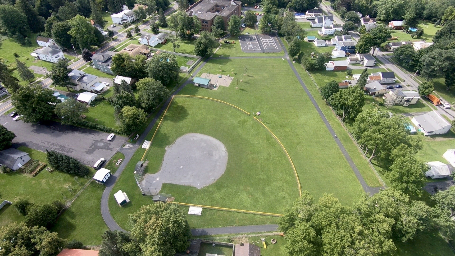 Babbott Park, Waterville - Located in the Center of Waterville, easily accessible from the St. Bernard's Church parking lot on Stafford Ave. The newly renovated park is complete with baseball field, play ground, 1/4 mile paved walking path, bathrooms, and more.