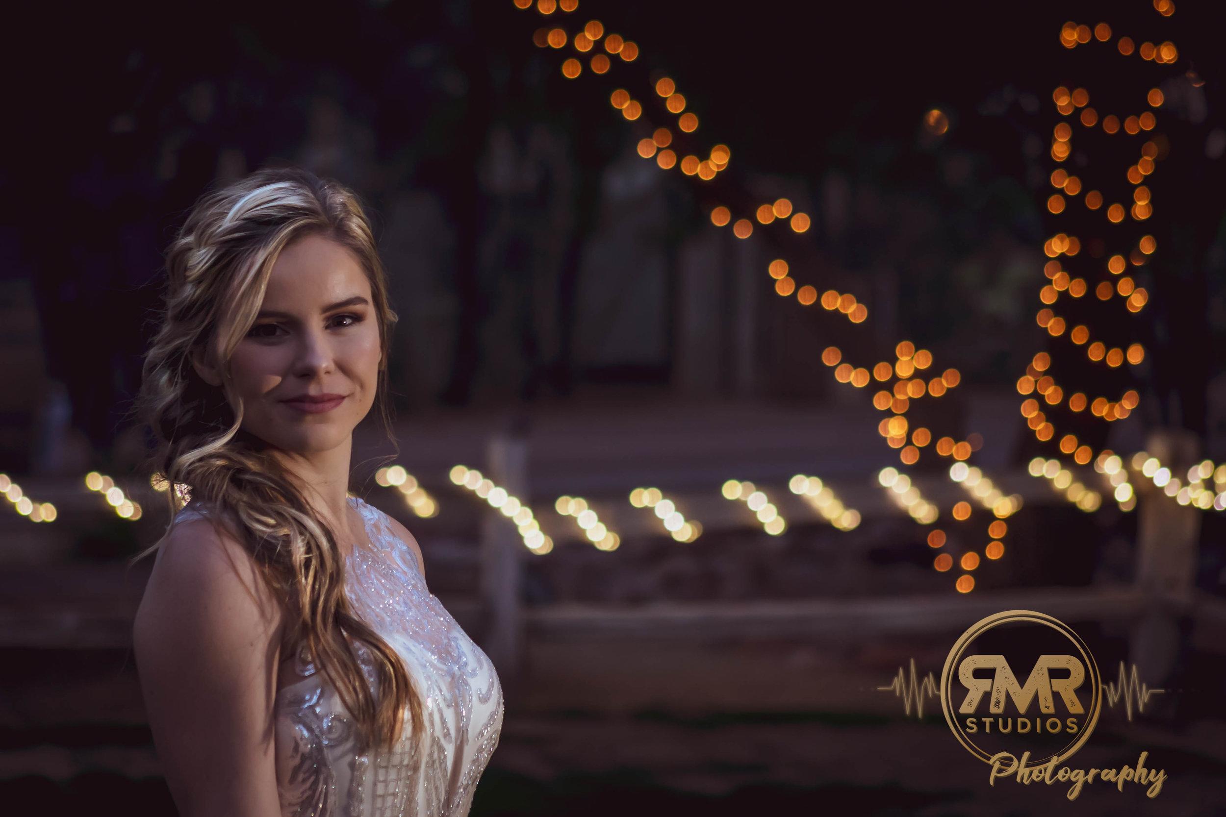 Bride 2 in front of light tree.jpg