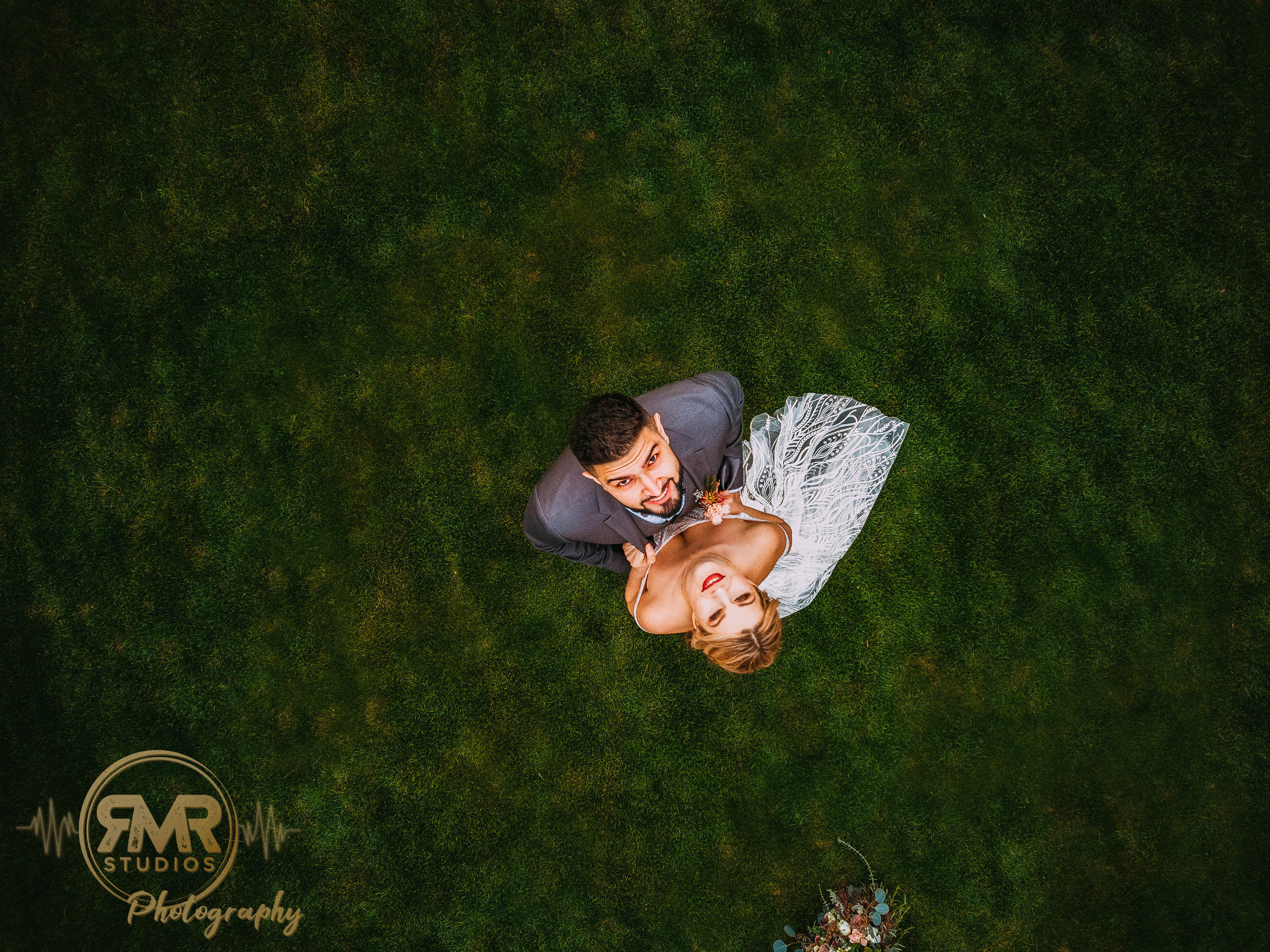 Bride and Groom looking up at drone-1.jpg