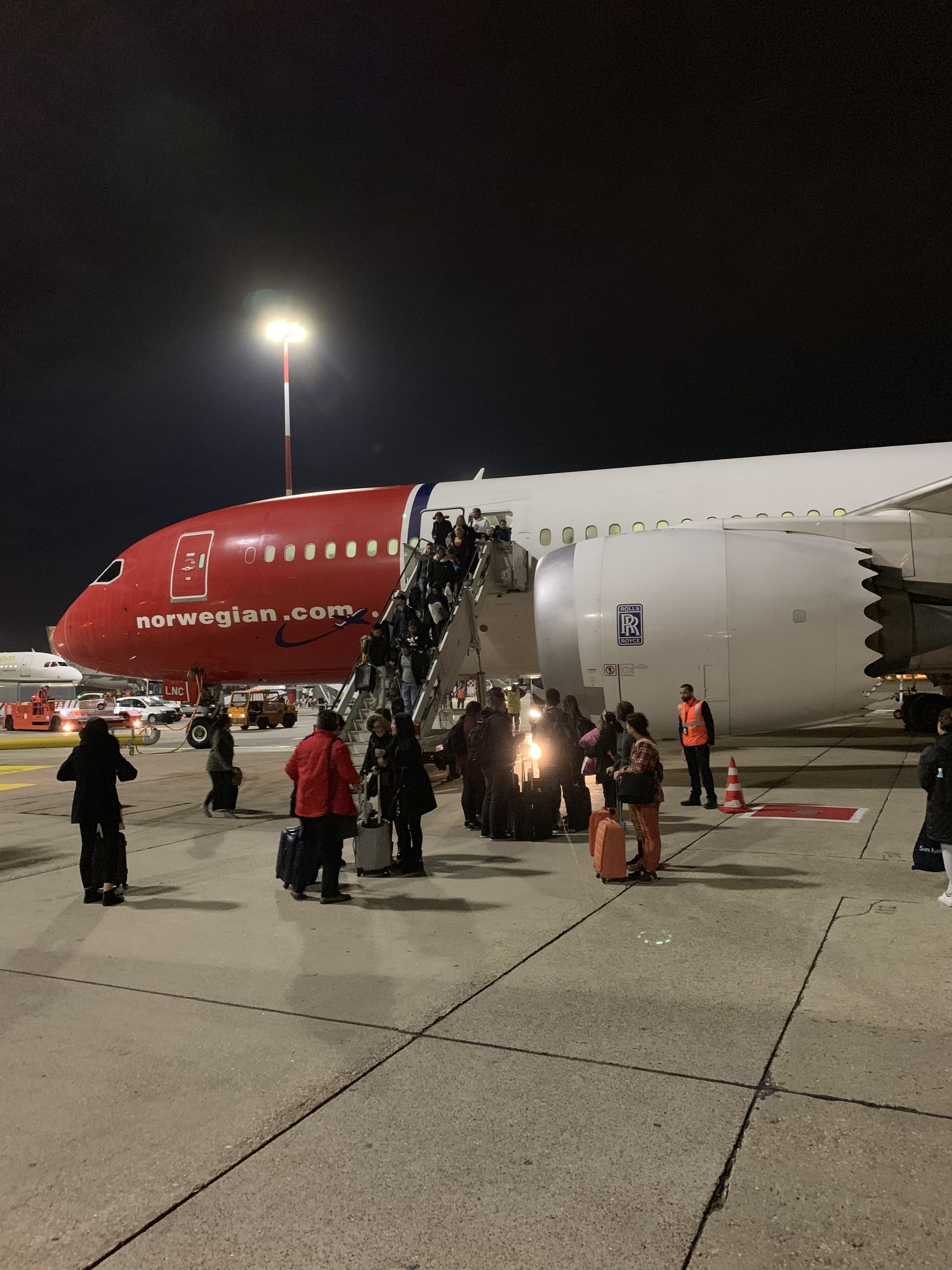 The Norwegian flight used bus gates on both ends, which meant passengers loaded and unloaded directly onto the tarmac and were ferried to the terminal on buses