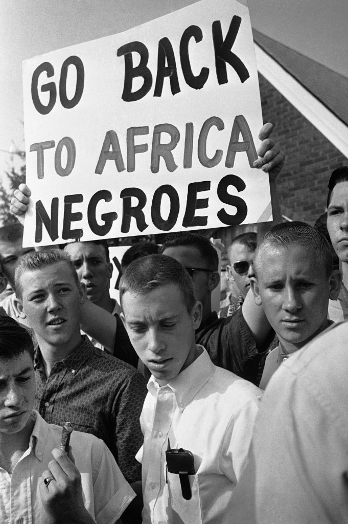 """This photo from the Civil Rights era captures the essence of Trump's """"Send her home"""" meme. Anyone non-white should go """"home,"""" he is signaling. (Photo: origin unknown)"""