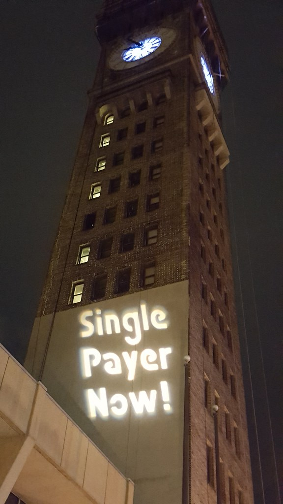 Maryland Solidarity Brigade Guerrilla Light Projections calling for Single Payer Now and Medicare For All on the clocktower  (  Backbone Campaign  )