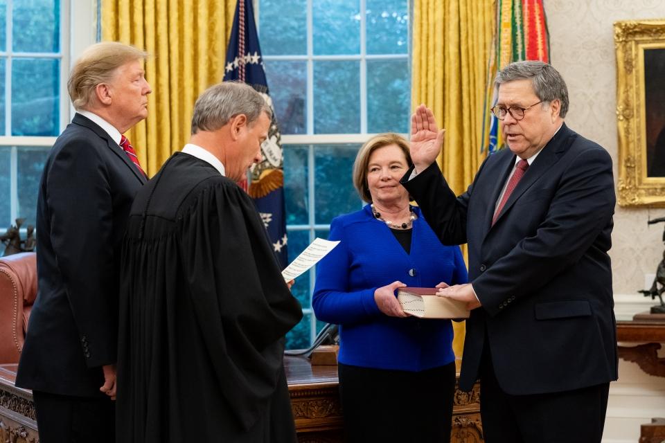 Attorney General William Barr being sworn in ( Wikipedia )