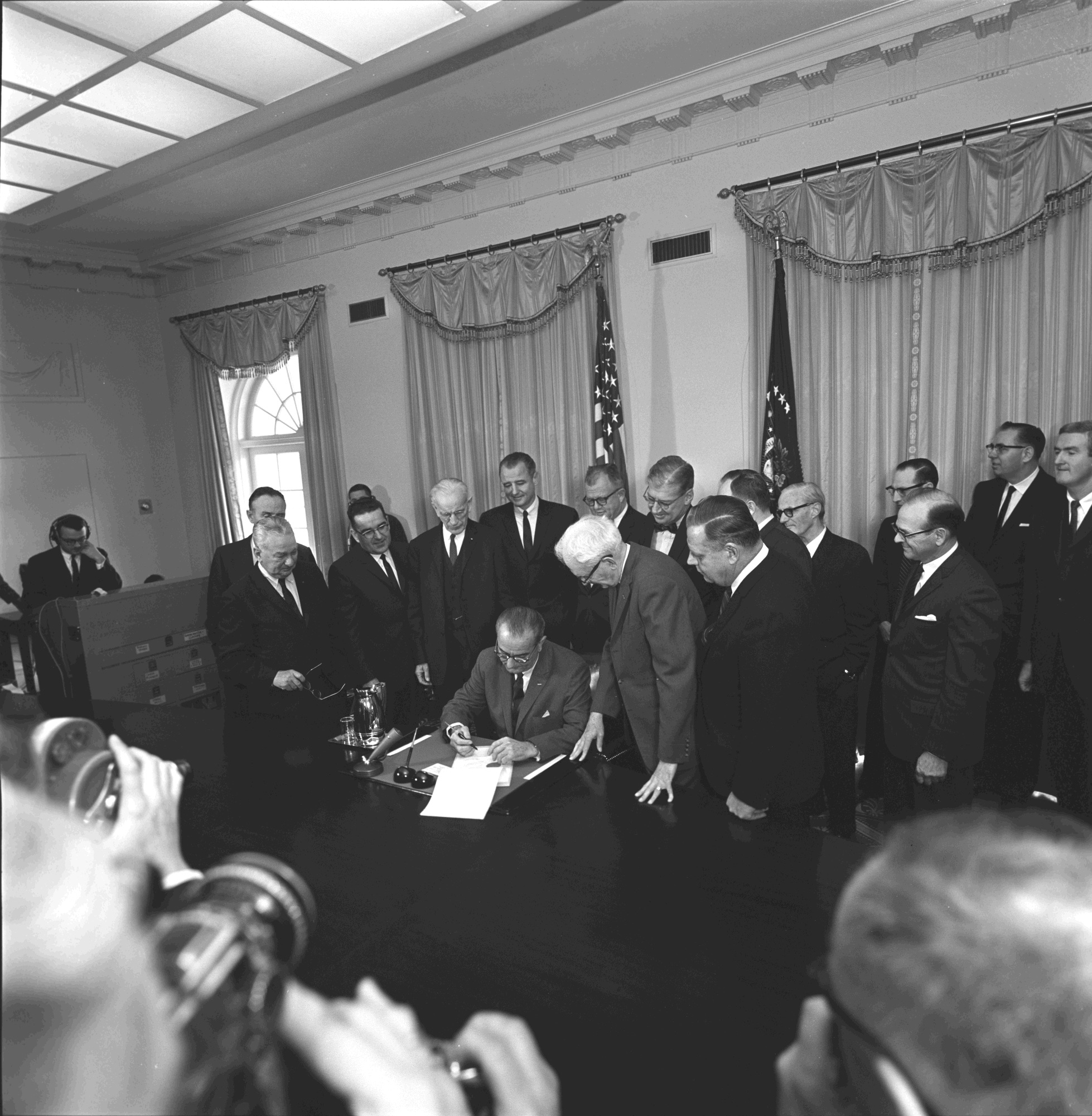 President Lyndon B. Johnson signing the Constitutional Amendment on the Poll Tax (Cecil W. Stoughton,  Wikimedia Commons )