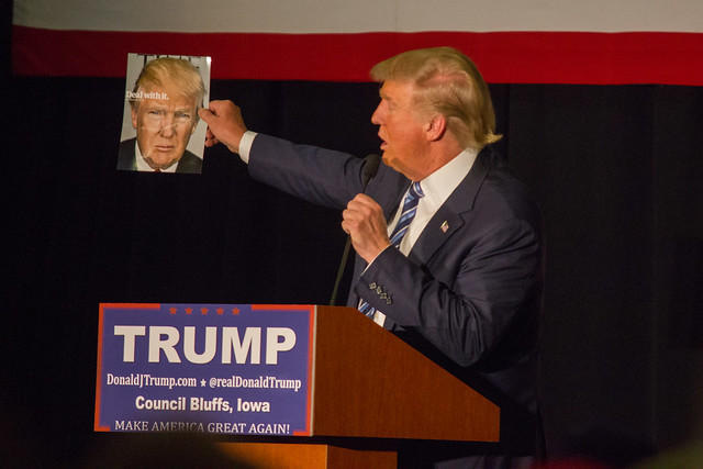 Donald Trump stares at a photo of himself ( Matt Johnson )