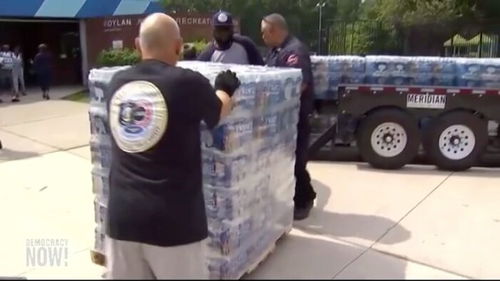 Water bottles being delivered in Newark, NJ ( Democracy Now! )