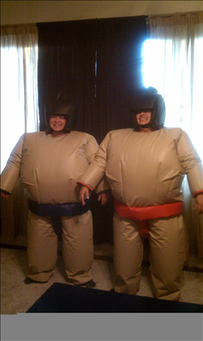 Wrestle siblings in Giant Sumo Suits. - Includes 9' pad