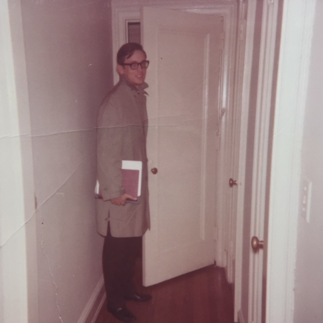 My dad in my parents' first apartment. He doesn't look like Charles, but I do think Charles probably had an overcoat just like that, and was always carrying books under his arm.