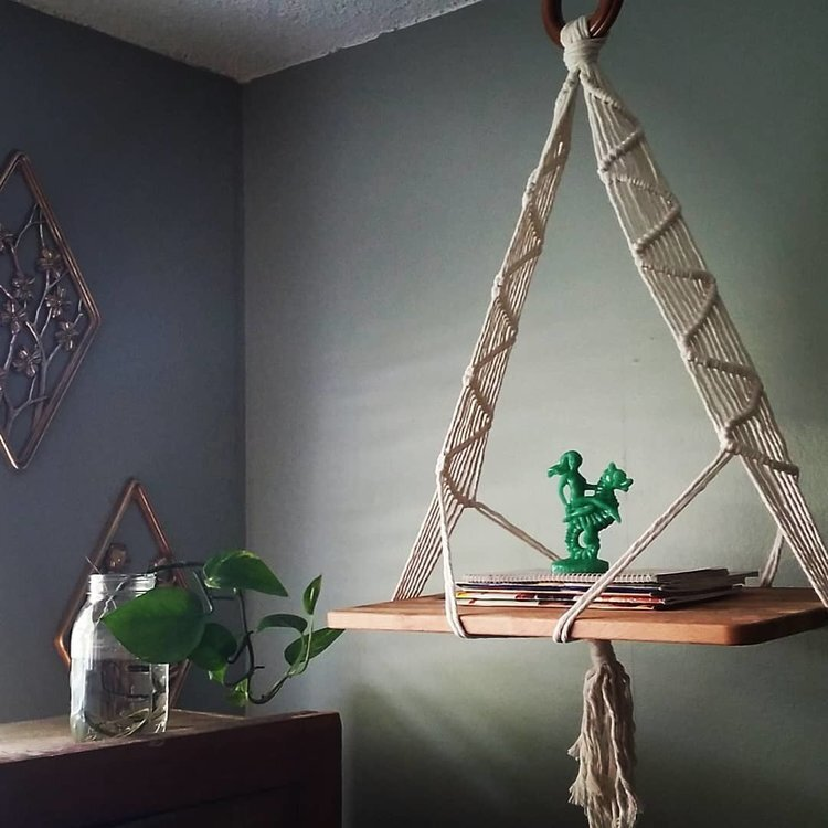 for that lil' nook - MacraMake your own hanging shelf for your books, plants, and more! Knot a two sided sling shelf that will hold a wooden board to support your items with a decorative, handmade style Cord, beads, and shelf board are all included along with hands on instruction and illustrated knotting guides.