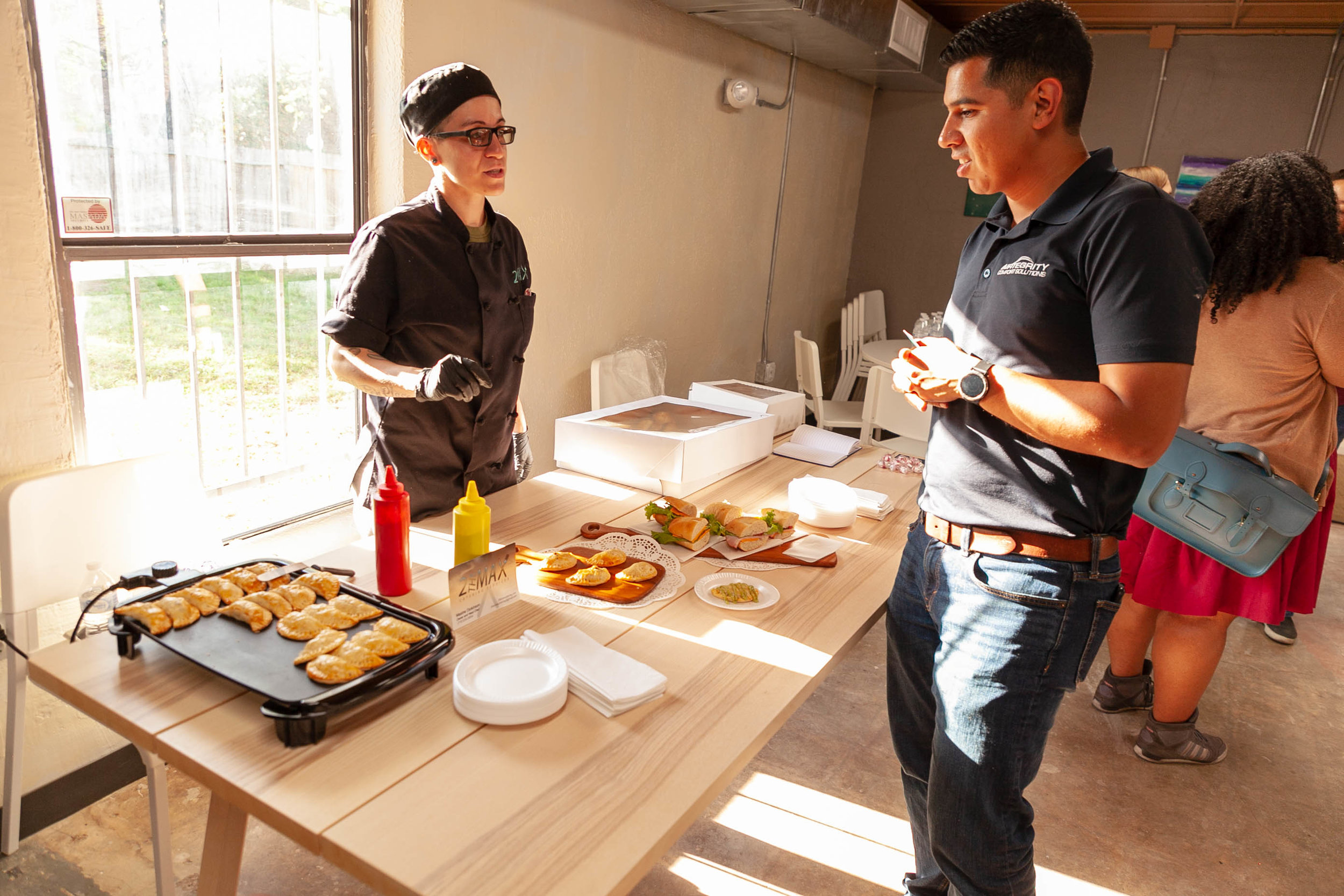 Food being prepared by 2theMax catering services. (Photo by Sentinel Contributing Reporter,  Luis Vazquez. )