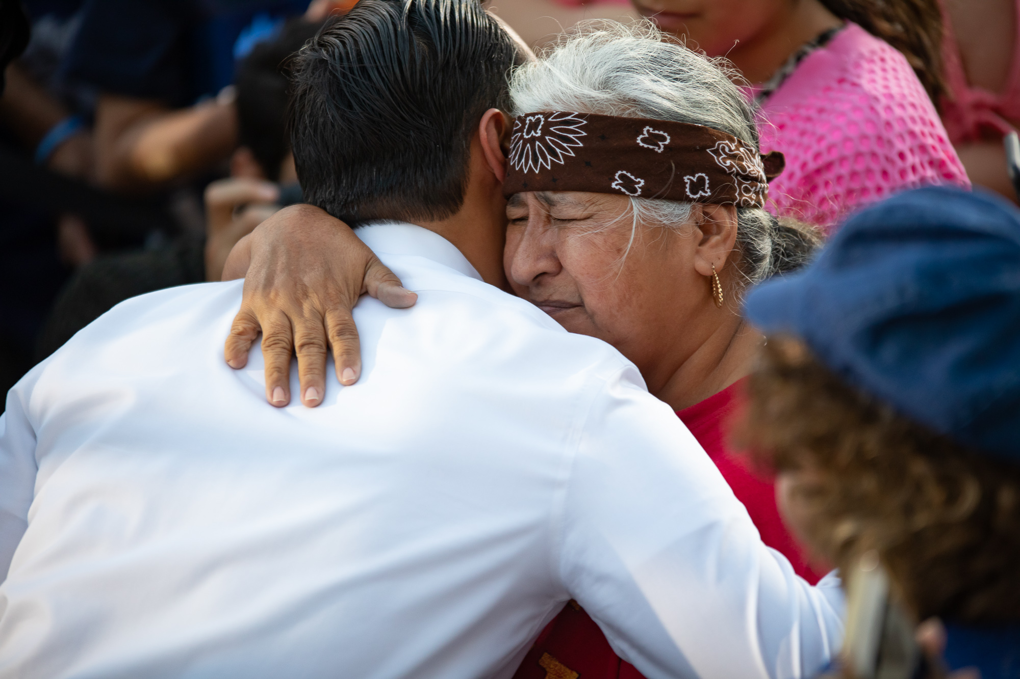 Castro is embraced by a rally attendee. (Photo by:  Joel Pena , Photographer - The San Antonio Sentinel)