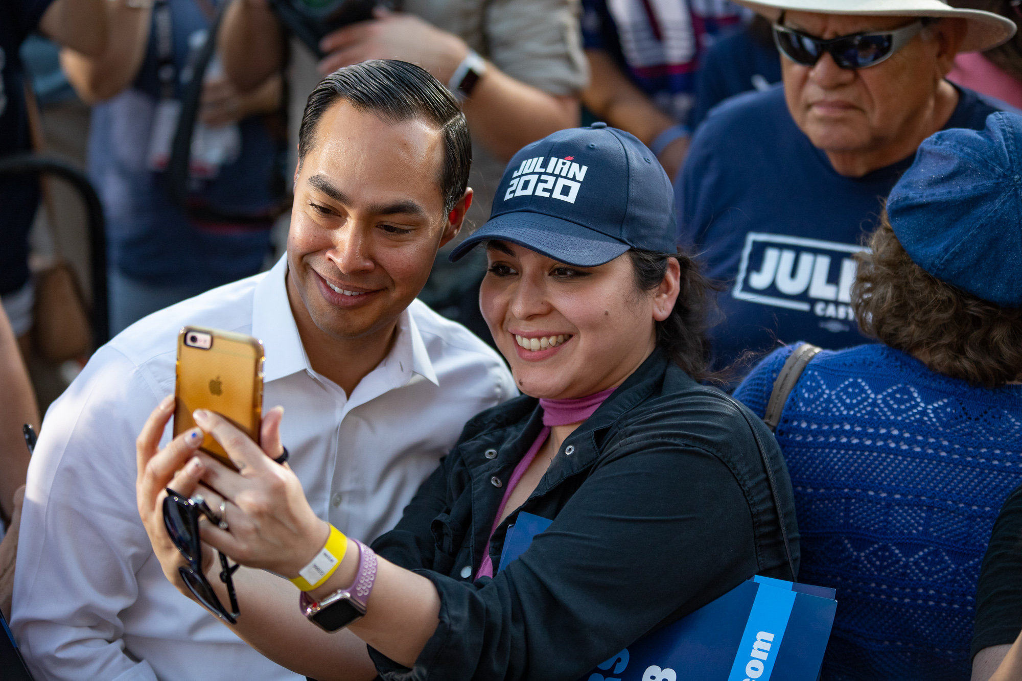 A fan snaps a selfie with Castro after the rally. (Photo by:  Joel Pena , Photographer - The San Antonio Sentinel)