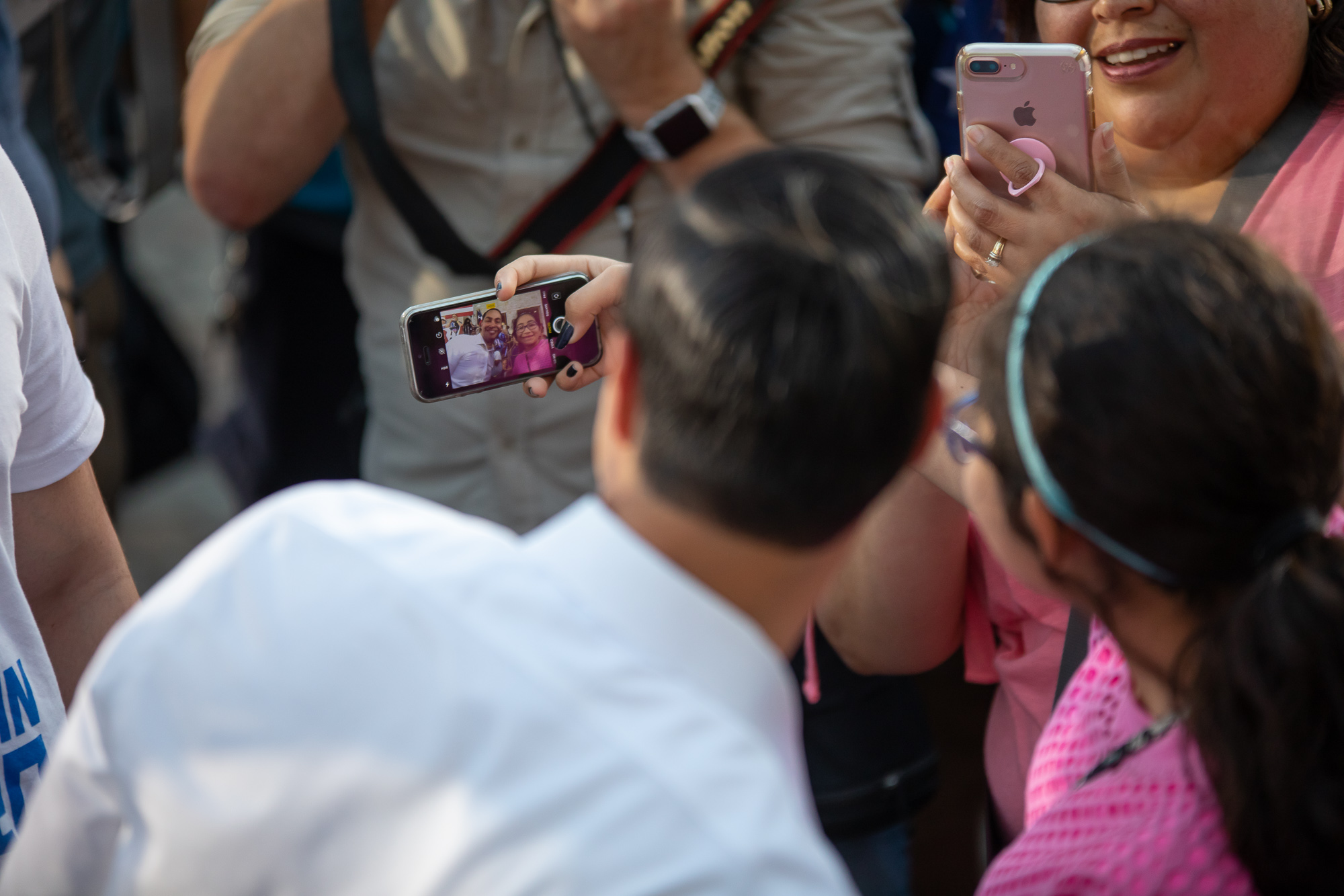A young fan snaps a photo with the Presidential hopeful. (Photo by:  Joel Pena , Photographer - The San Antonio Sentinel)