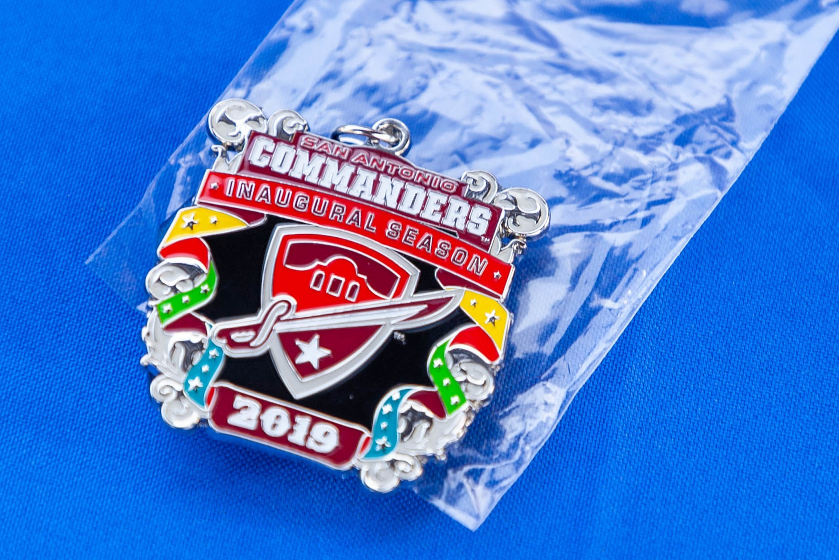 Commanders Fiesta medals were available at the event. (Photo by:  Luis Vazquez , Contributing Reporter - San Antonio Sentinel)