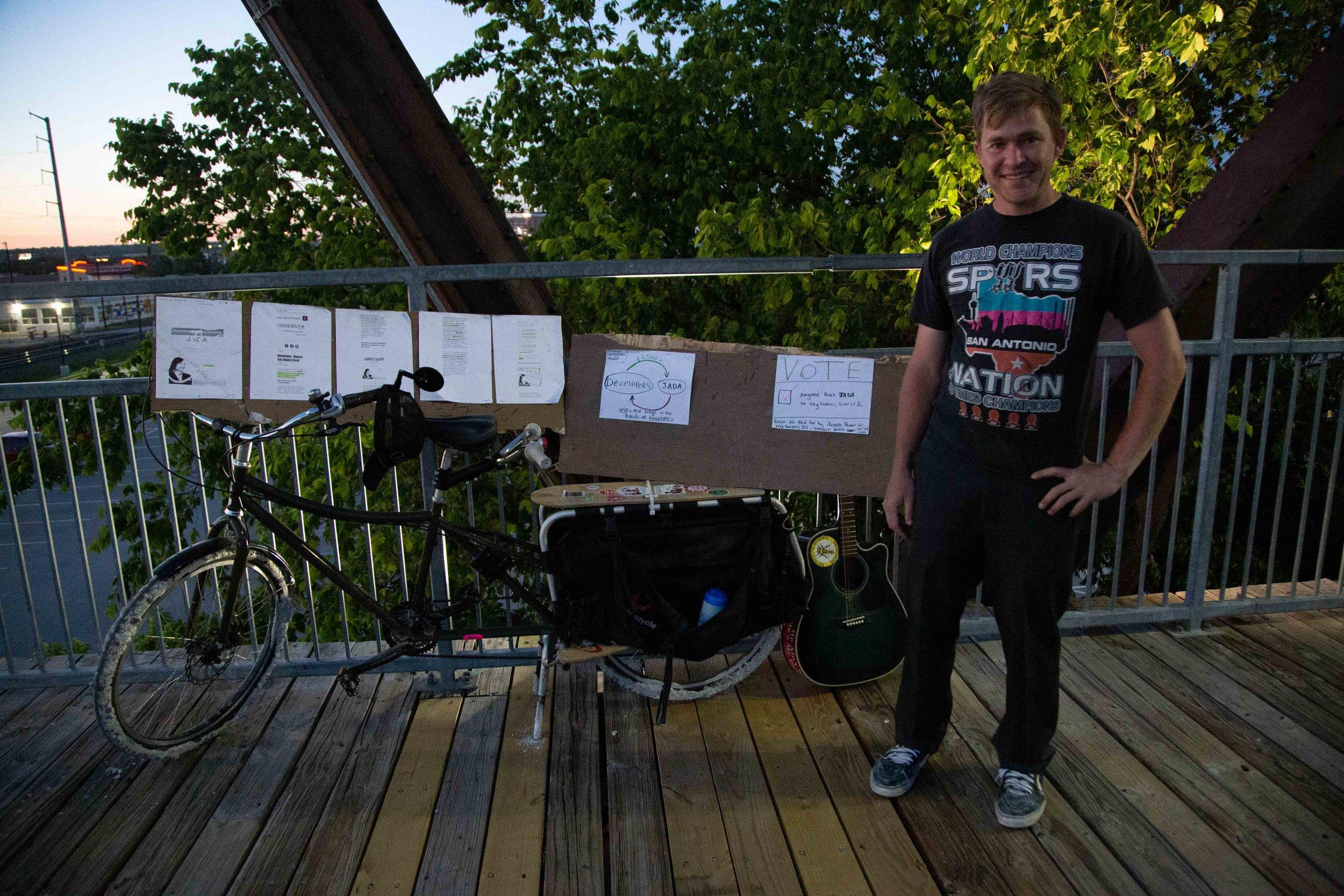 Joseph Powell campaigns on Hays St. Bridge. (Photo Credit:  GA Media Productions )