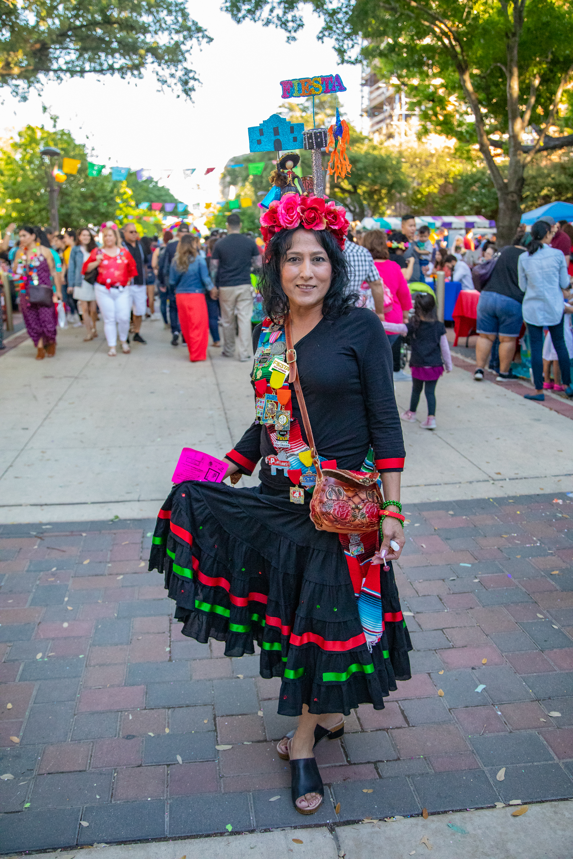 Sandi Estrada in her festive Fiesta attire. (Photo by:  Joel Pena  - SA Sentinel Photographer.)