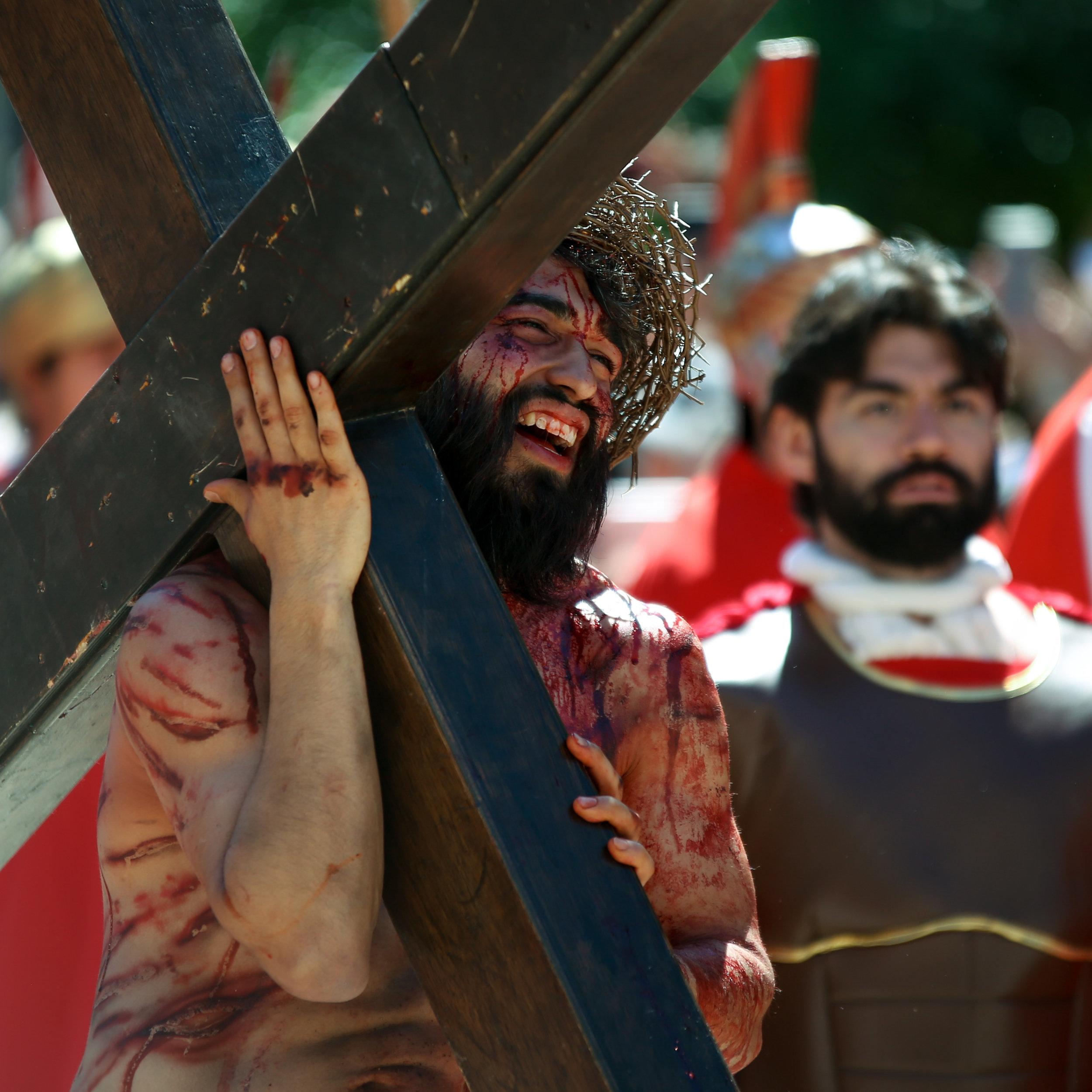 Christ (played by Charles Ramirez) carries his cross through the city. (Photo by Jonathan Guajardo - Editor, SA Sentinel)