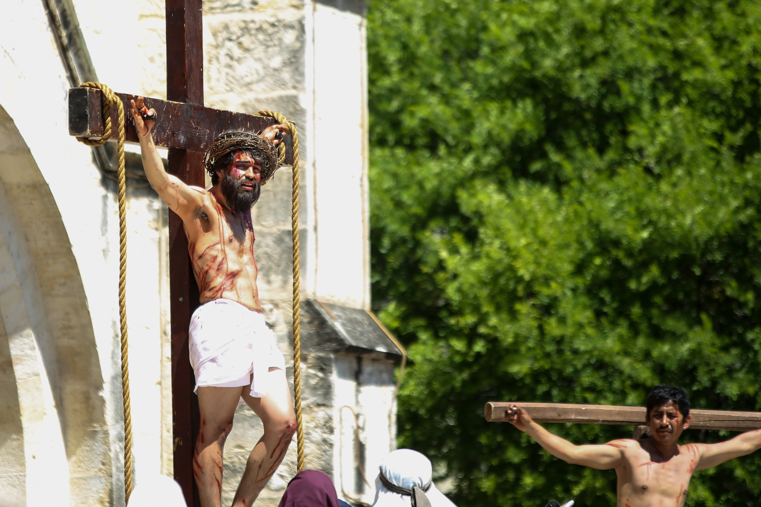 Christ (played by Charles Ramirez) hangs on the cross in front of San Fernando Cathedral. (Photo by Jonathan Guajardo - Editor, SA Sentinel)