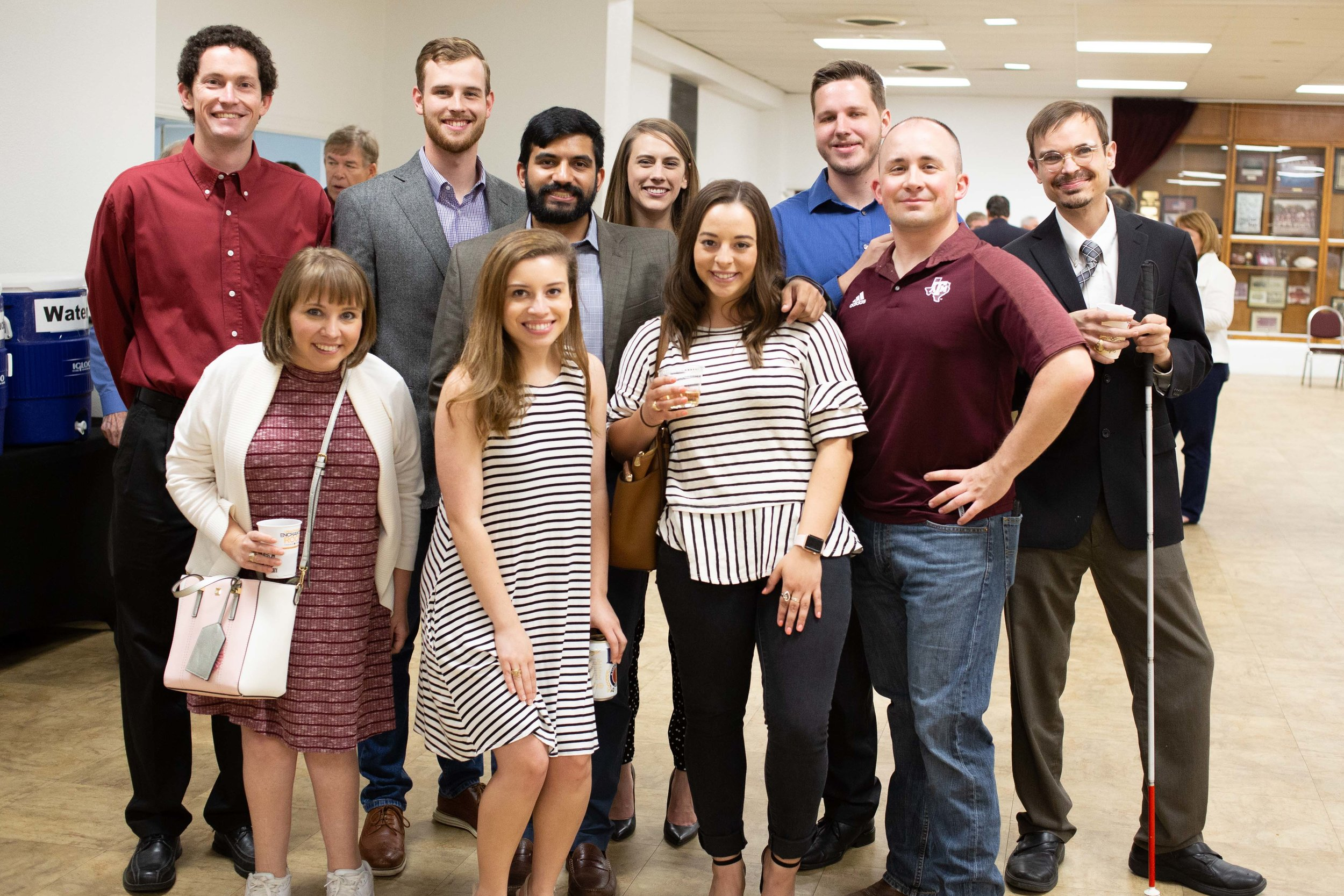 Texas A&M Former Students pose for a photo after the Muster ceremony. (Photo by  GA Media Media Productions .)